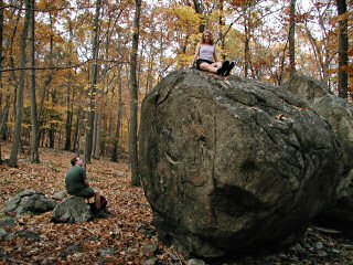 Zhanna sitting on boulder