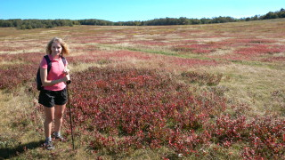 Zhanna in pink, purple colorful meadow