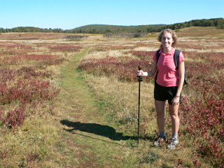 Zhanna with pack and hiking pole ready to walk