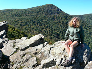 Zhanna on rocks, mountain in background