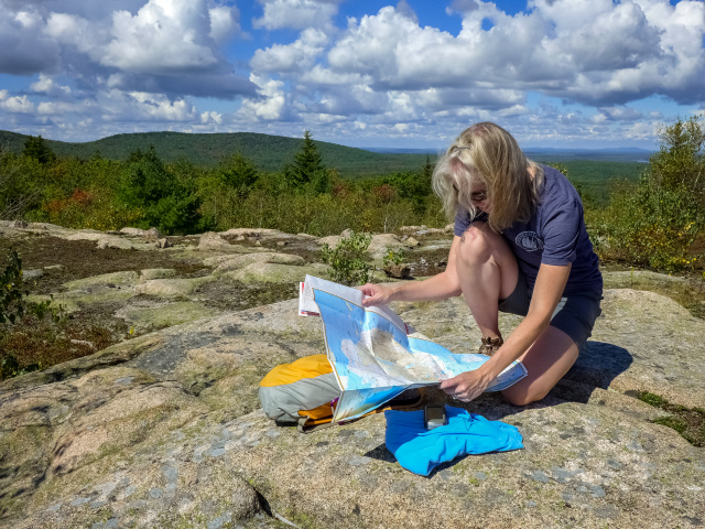 Studying the map before looking for the next abandoned trail!