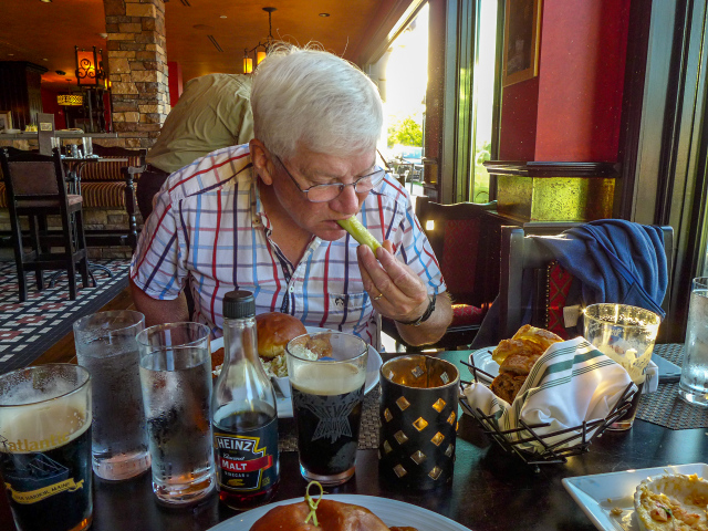 Dad is enjoying his food and Guinness